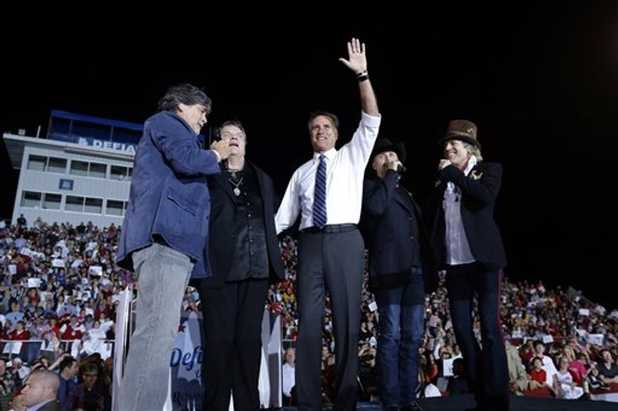 """Republican presidential candidate and former Massachusetts Gov. Mitt Romney waves as he sings """"God Bless America"""" as he campaigns at the football stadium at Defiance High School in Defiance, Ohio, Thursday, Oct. 25, 2012, with from left to right, Randy Owen, Meat Loaf, John Rich and Big Kenny. (AP Photo/Charles Dharapak)"""