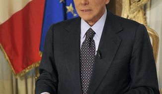 ** FILE ** In this photo released on Thursday, Oct. 25, 2012, former Italian premier Silvio Berlusconi tapes a video message where he announces he will not run for a fourth term as premier in spring elections. (AP Photo/Livio Anticoli, Berlusconi press office)