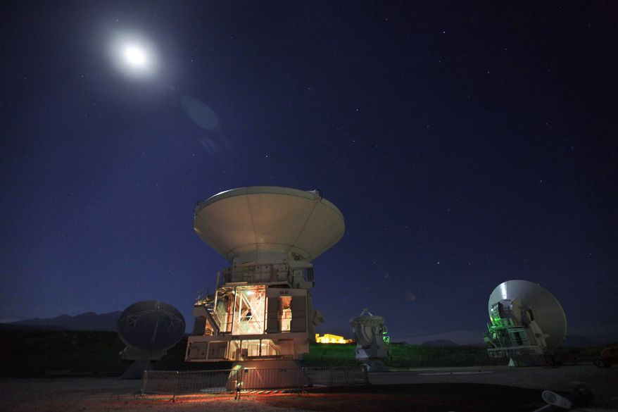 **FILE** The moon shines over radio antennas at the operations support facility of the Atacama Large Millimeter/submillimeter Array (ALMA) in the Atacama desert in northern Chile, one of the worlds largest astronomy projects, on Sept. 26, 2012. Linked as a single giant telescope, the radio antennas pick up wavelengths of light longer than anything visible to the human eye and colder than infrared telescopes, which are good at capturing images of distant suns but miss planets and clouds of gases from which stars are formed. (Associated Press)