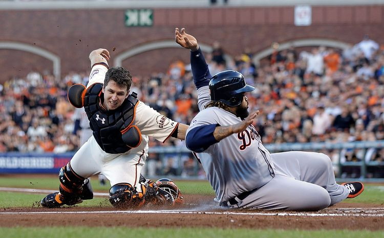 Detroit Tigers 1B Prince Fielder is tagged out at home plate by San Francisco Giants catcher Buster Posey during the second inning of Game 2 of the World Series in San Francisco on Oct. 25, 2012. (Associated Press)