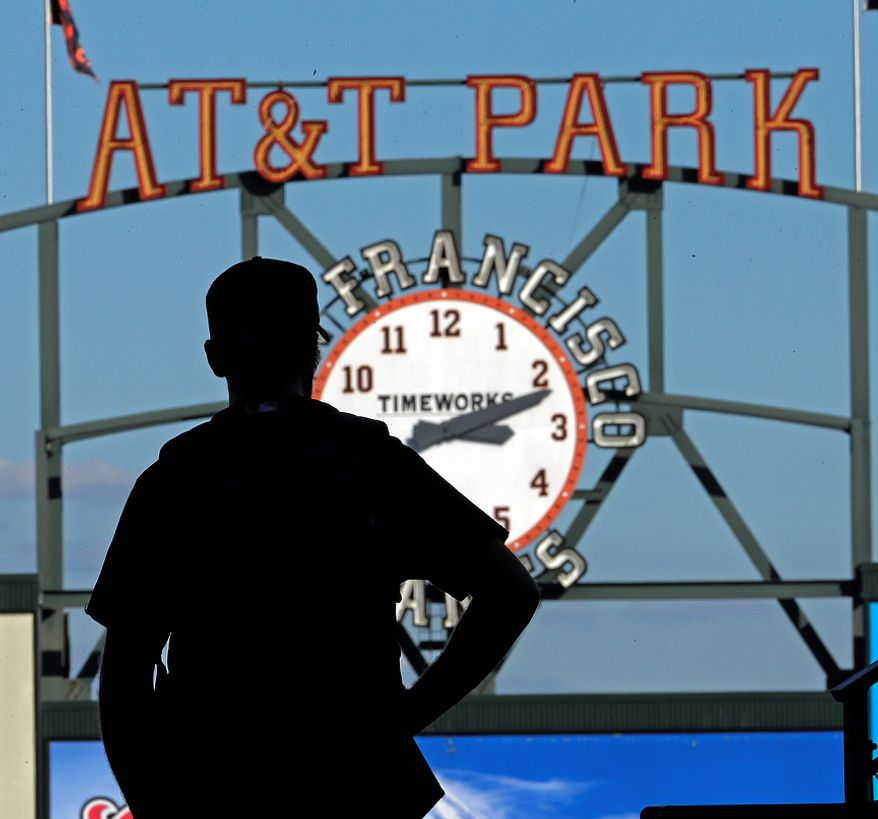 A fan watches bating practice before Game 2 of the World Series between the San Francisco Giants and the Detroit Tigers on Oct. 25, 2012, in San Francisco. (Associated Press)
