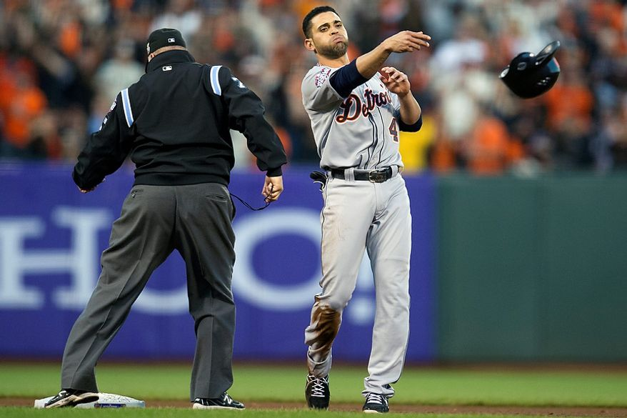 Detroit Tigers 2B Omar Infante throws his helmet after being caught stealing during the fourth inning of Game 2 of the World Series against the San Francisco Giants on Oct. 25, 2012, in San Francisco. (Associated Press/The Sacramento Bee)