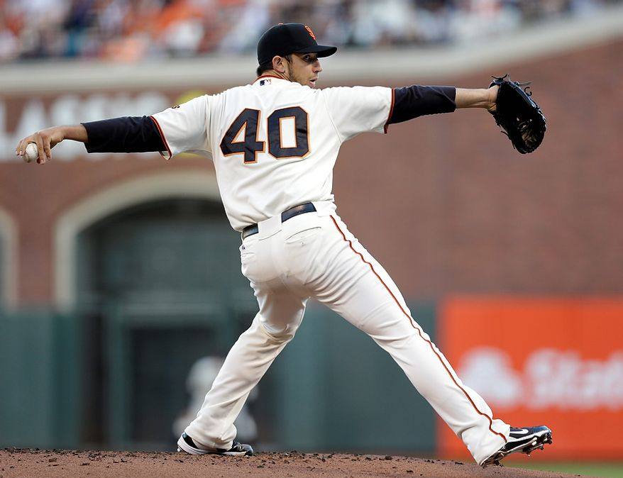San Francisco Giants starting pitcher Madison Bumgarner throws during the first inning of Game 2 of the World Series against the Detroit Tigers on Oct. 25, 2012, in San Francisco. (Associated Press)
