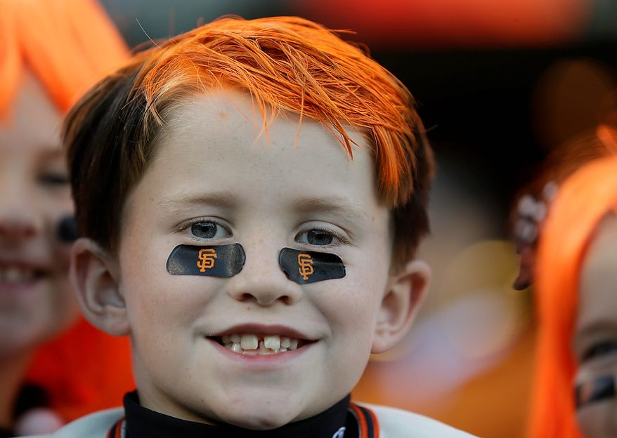 A San Francisco Giants fan waits for the start of Game 2 of the World Series between the Giants and Detroit Tigers in San Francisco on Oct. 25, 2012. (Associated Press)