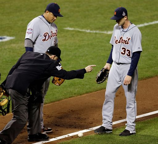 Detroit Tigers 3B Miguel Cabrera and pitcher Drew Smyly (33) watch as umpire Dan Iassogna calls a bunt by San Francisco Giants LF Gregor Blanco fair during the seventh inning of Game 2 of the World Series in San Francisco on Oct. 25, 2012. (Associated Press)