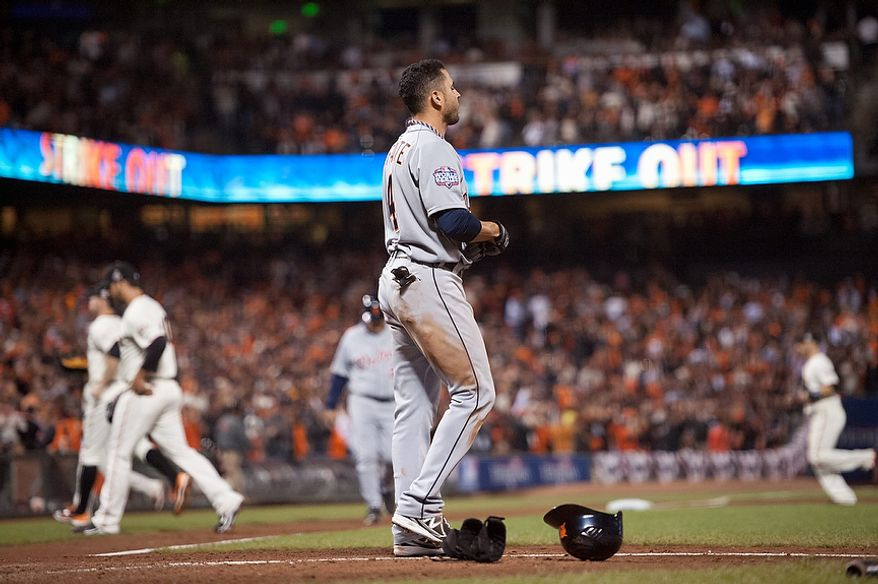 The San Francisco Giants return to the dugout after Detroit Tigers 2B Omar Infante struck out to end the top of the sixth inning of Game 2 of the World Series in San Francisco on Oct. 25, 2012. (Associated Press/The Sacramento Bee)