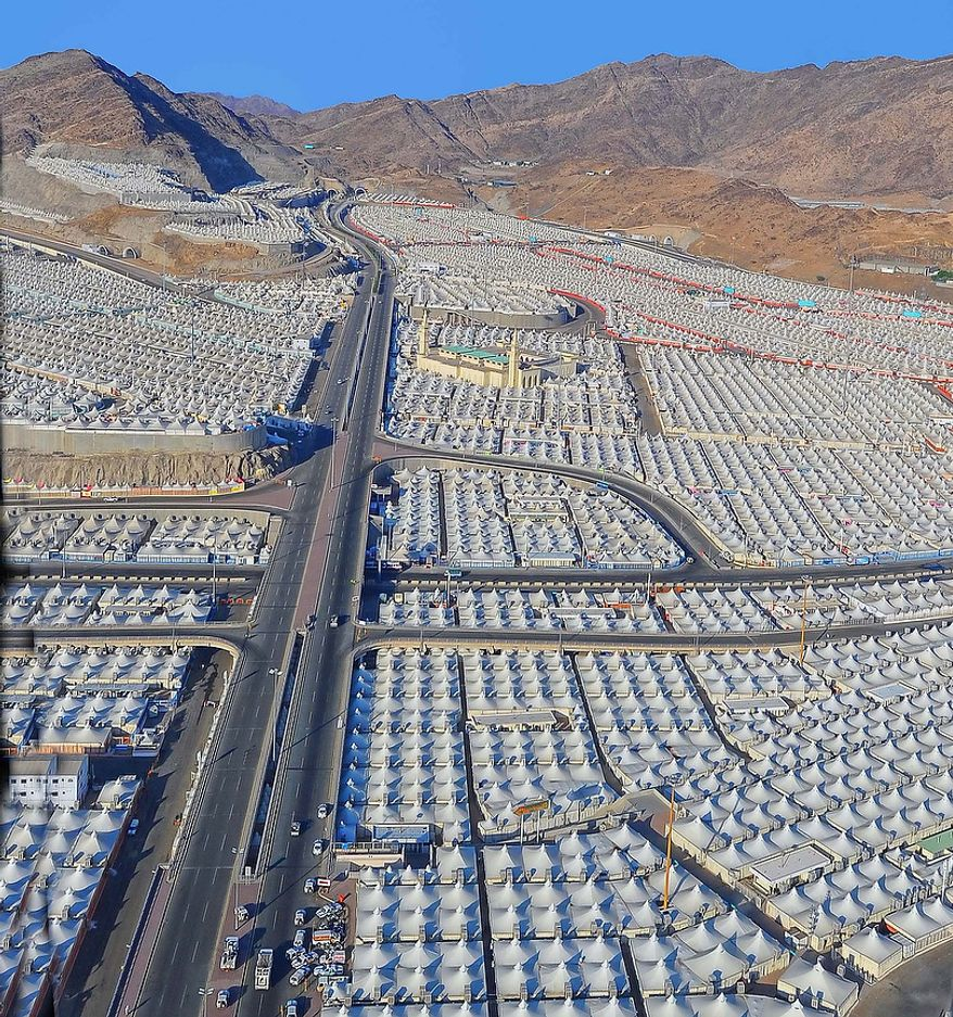 A large tent encampment covers the Plain of Arafat near Mecca, Saudi Arabia, on Oct 25. 2012, as millions converge for the annual Hajj, the most important pilgrimage of the Islamic faith. Oct 25. was is Arafat Day, the second day of the Hajj pilgrimage on which it is said that the religion had been perfected and the following day is the first day of the major Islamic Holiday of Eid ul-Adha. (Associated Press/Saudi Press Agency)