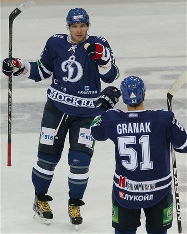 In this photo taken on Monday, Oct. 1, 2012, Washington Capitals star forward Alexander Ovechkin, left, of Russia, seen during the Continental Hockey League, or KHL, ice hockey match between Dynamo Moscow and Neftekhimik, in Moscow. Ovechkin has returned to his former Russian team Dynamo Moscow during the NHL lockout. The KHL team said in a statement Wednesday, Sept. 19, 2012, that they have signed the Capitals star to a contract that lasts until the lockout ends. (AP Photo/Alexander Safonov)