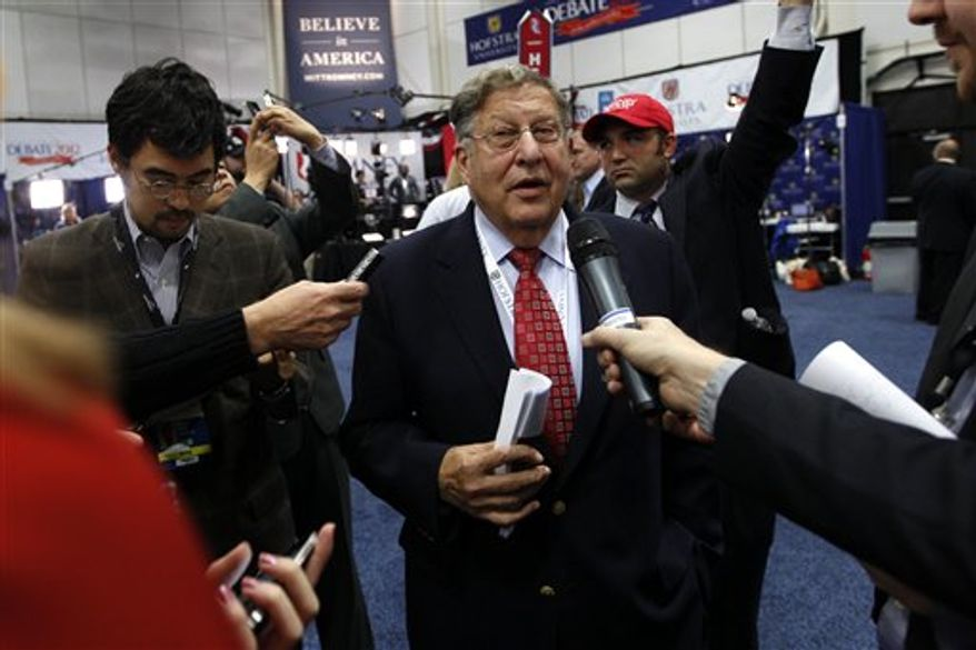 Former New Hampshire Gov. John Sununu speaks to reporters in the spin room on behalf of Mitt Romney after the second presidential debate at Hofstra University in Hempstead, N.Y., on Oct. 16, 2012. (Associated Press) ** FILE **
