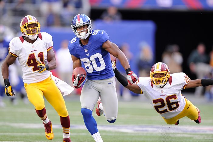 New York Giants wide receiver Victor Cruz (80) runs past Washington Redskins free safety Madieu Williams (41) and a diving cornerback Josh Wilson (26) on his way to a 77-yard game-winning touchdown late in the fourth quarter at MetLife Stadium, East Rutherford, N.J., Oct. 21, 2012. (Preston Keres/Special to The Washington Times)
