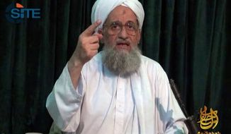 Al Qaeda leader Ayman al-Zawahiri is seen here in a still image from a web posting by the terrorist group's media arm, as-Sahab, on July 27, 2011. (Associated Press)
