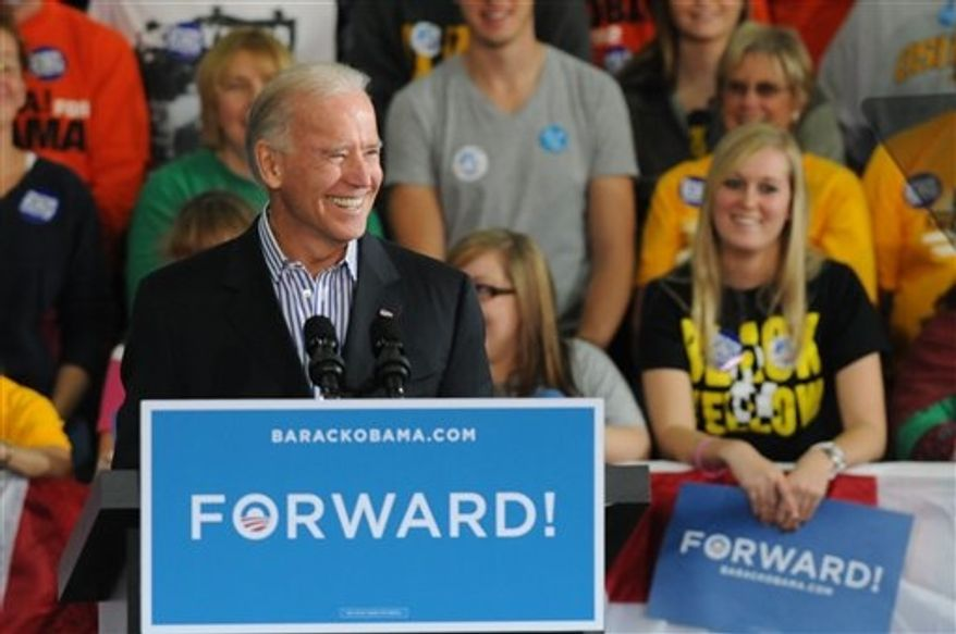 ** FILE ** Vice President Joe Biden urges supporters to re-elect President Barack Obama during a speech at the University of Wisconsin-Oshkosh that largely focused on criticism of Republican challenger Mitt Romney and his running mate, Paul Ryan of Janesville on Friday, Oct. 26, 2012, in Oshkosh, Wis. (AP Photo/The Oshkosh Northwestern, Joe Sienkiewicz)