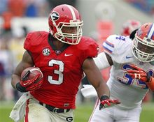 Georgia running back Todd Gurley (3) gets around Florida linebacker Lerentee McCray for yardage during the first half of an NCAA college football game, Saturday, Oct. 27, 2012, in Jacksonville, Fla. (AP Photo/John Raoux)