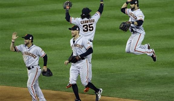 San Francisco Giants' Brandon Crawford (35) and Angel Pagan leap as they celebrate after Game 3 of baseball's World Series against the Detroit Tigers Saturday, Oct. 27, 2012, in Detroit. (AP Photo/Paul Sancya )