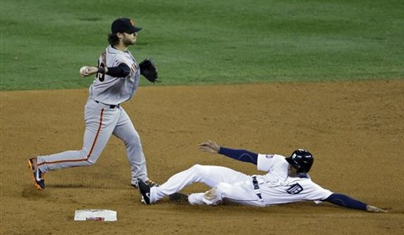 San Francisco Giants shortstop Brandon Crawford throws over Detroit Tigers' Austin Jackson to turn a double play on a ball hit by Quintin Berry during the third inning of Game 3 of baseball's World Series Saturday, Oct. 27, 2012, in Detroit. (AP Photo/Patrick Semansky)