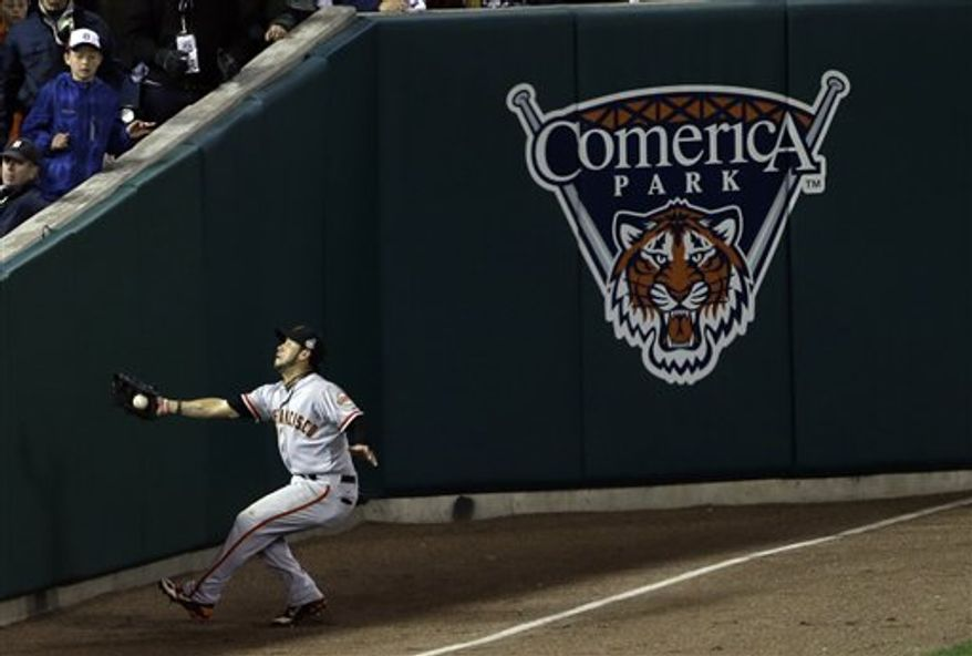 San Francisco Giants right fielder Gregor Blanco makes a catch near the wall of a ball hit by Detroit Tigers' Jhonny Peralta during the ninth inning of Game 3 of baseball's World Series Saturday, Oct. 27, 2012, in Detroit. (AP Photo/Paul Sancya )