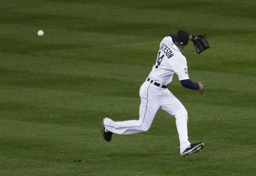 Detroit Tigers center fielder Austin Jackson (14) misses the ball hit by San Francisco Giants shortstop Brandon Crawford during the second inning of Game 3 of baseball's World Series against the San Francisco Giants Saturday, Oct. 27, 2012, in Detroit. (AP Photo/Patrick Semansky)