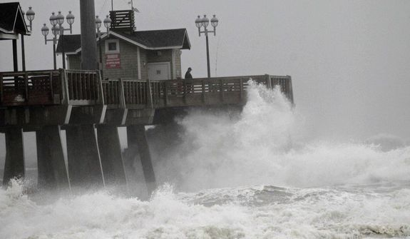 Large waves generated by Hurricane Sandy crash into Jeanette's Pier in Nags Head, N.C., Saturday, Oct. 27, 2012, as the storm moves up the East Coast. (AP Photo/Gerry Broome)