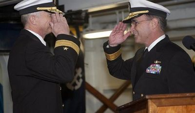 ** FILE ** Rear Adm. Craig S. Faller (left), commander of Carrier Strike Group (CSG) 3, is relieved by Rear Adm. Charles M. Gaouette (right) during a change of command ceremony in the forecastle aboard the Nimitz-class aircraft carrier USS John C. Stennis in Bremerton, Wash., on Thursday, April 5, 2012. (AP Photo/U.S. Navy, Kenneth Abbate)