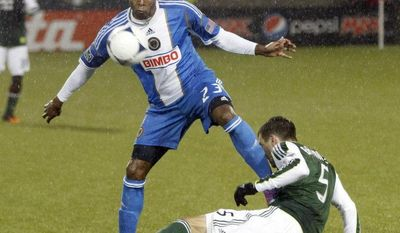 ** FILE ** D.C. United acquired Lionard Pajoy, left, from the Philadelphia Union for midfielder Danny Cruz in this March 12, 2012, file photo. (AP Photo/Don Ryan)
