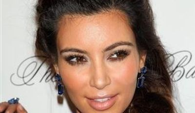 This Oct. 22, 2012, photo released by Starpix shows TV personality Kim Kardashian at Gabrielle's Angel Foundation 2012 Angel Ball cancer research benefit at Cipriani Wall Street in New York. (AP Photo/Starpix, Andrew Toth)