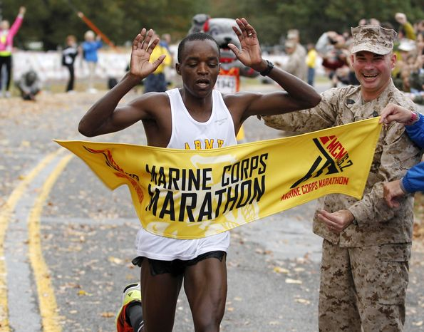 Augustus Maiyo of Colorado Springs, Co. crosses the finish line as he wins the Marine Corps Marathon with a time of 2:20:20 in Washington, on Sunday,  Oct. 28,  2012.More than 30,000 people participated