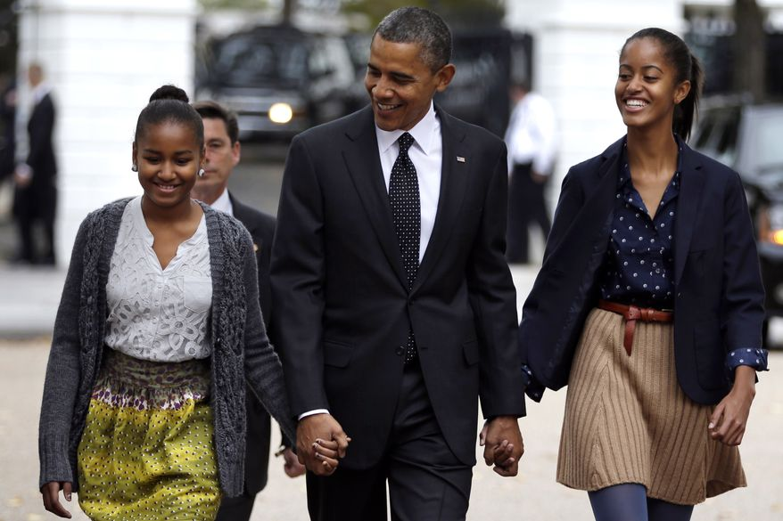 President Obama walks to St. John's Episcopal Church from the White House with daughters Sasha (left) and Malia on Sunday, Oct. 28, 2012, in Washington. (AP Photo/Jacquelyn Martin)