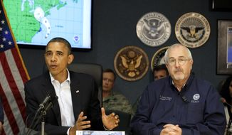 President Obama (left) attends a briefing with Federal Emergency Management Agency Administrator Craig Fugate at the National Response Coordination Center at FEMA headquarters in Washington on Sunday, Oct. 28, 2012. (AP Photo/Jacquelyn Martin)