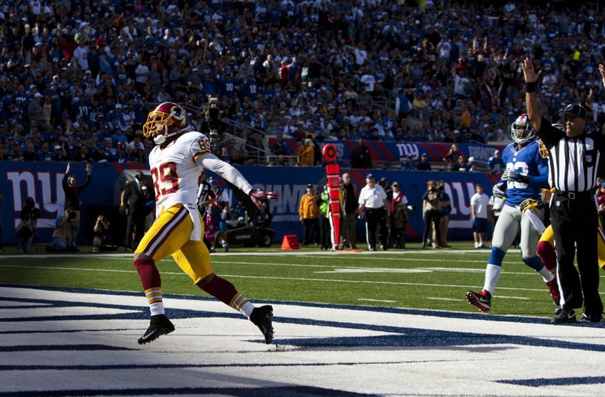 Washington Redskins wide receiver Santana Moss (89) scores the first touchdown on a pass from quarterback Robert Griffin III (10) in the second quarter against the New York Giants at Metlife Stadium, East Rutherford, N.J., Oct. 21, 2012 (Craig Bisacre/The Washington Times)