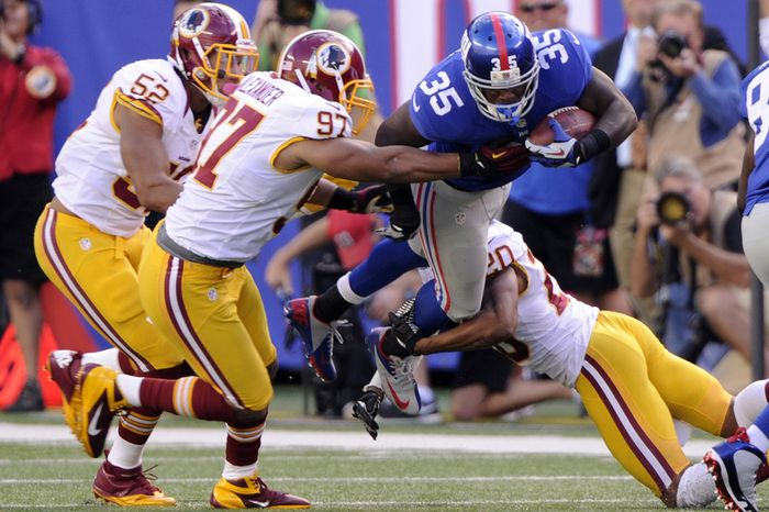 New York Giants running back Andre Brown (35) gains a first down before he can be tackled by Washington Redskins linebacker Lorenzo Alexander (97) and  defensive back Cedric Griffin (20) in the fourth quarter at MetLife Stadium, East Rutherford, N.J., Oct. 21, 2012. (Preston Keres/Special to The Washington Times)