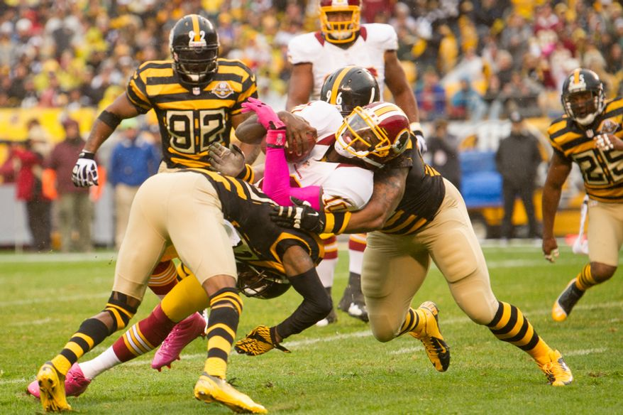 Washington Redskins quarterback Robert Griffin III (10) is stopped at the two yard line after trying to run the ball in himself in the second quarter as the Washington Redskins take on the Pittsburgh Steelers at Heinz Field, Pittsburgh, Pa., Sunday, October 28, 2012. (Andrew Harnik/The Washington Times)