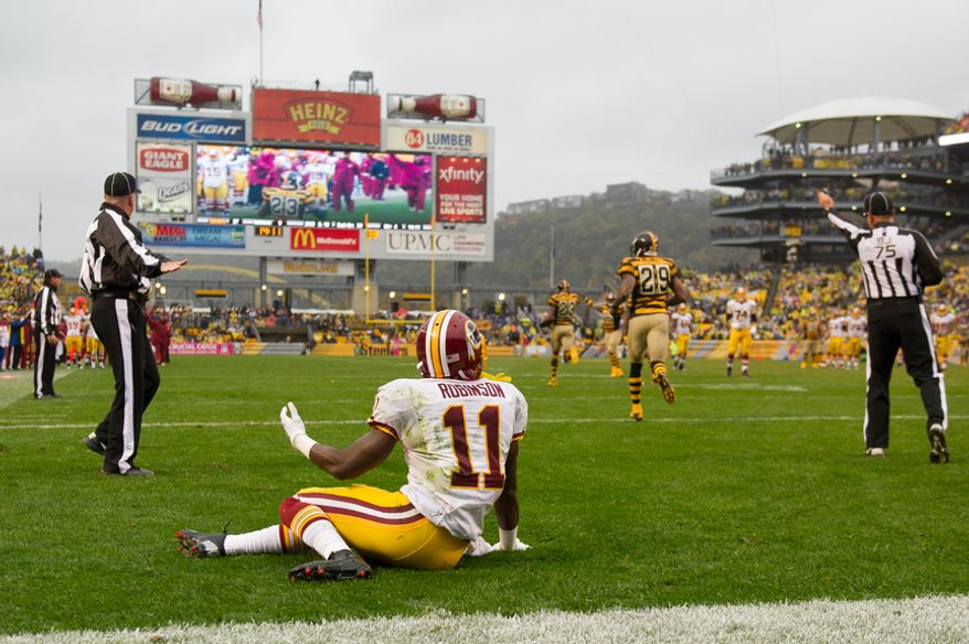 Washington Redskins wide receiver Aldrick Robinson (11) sits on the field in disbelief after a pass intended to him is intercepted by Pittsburgh Steelers cornerback Keenan Lewis (23) as the Washington Redskins take on the Pittsburgh Steelers at Heinz Field, Pittsburgh, Pa., Sunday, October 28, 2012. The interception would be challenged by the replay assistant and the play was ruled an incomplete. (Andrew Harnik/The Washington Times)