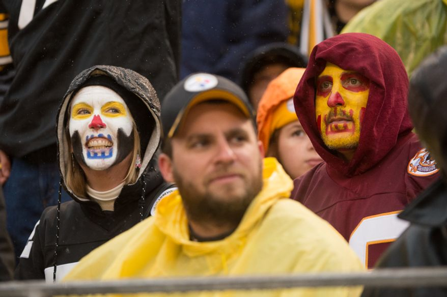 A Pittsburgh Steelers fan and Washington Redskins fan paints their faces for halloween as the Washington Redskins take on the Pittsburgh Steelers at Heinz Field, Pittsburgh, Pa., Sunday, October 28, 2012. (Andrew Harnik/The Washington Times)