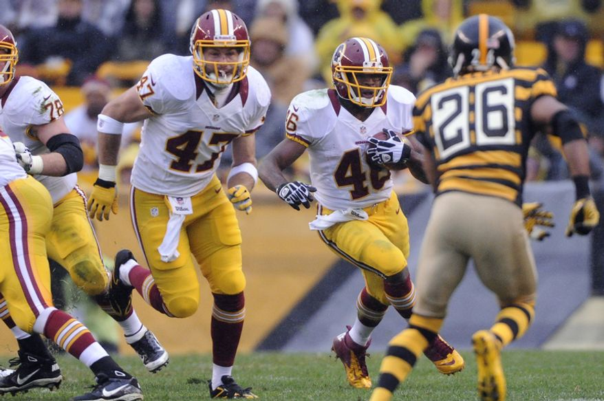 In his first game back, Washington Redskins tight end Chris Cooley (47) blocks for running back Alfred Morris (46) during this second quarter run at Heinz Field, Pittsburgh, Pa., Oct. 28, 2012. (Preston Keres/Special to The Washington Times)