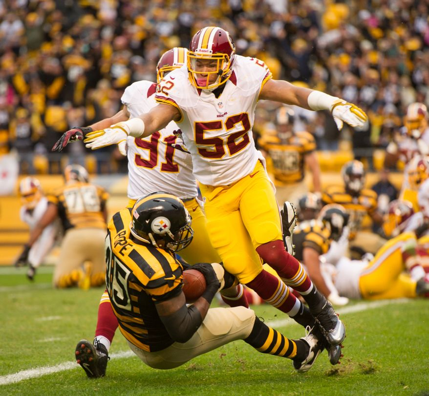 Washington Redskins outside linebacker Ryan Kerrigan (91) and Washington Redskins linebacker Keenan Robinson (52) knock down Pittsburgh Steelers tight end Leonard Pope (45) as he scores on a 1 yard pass play to put the Steelers up 7-0 in the first quarter as the Washington Redskins take on the Pittsburgh Steelers at Heinz Field, Pittsburgh, Pa., Sunday, October 28, 2012. (Andrew Harnik/The Washington Times)