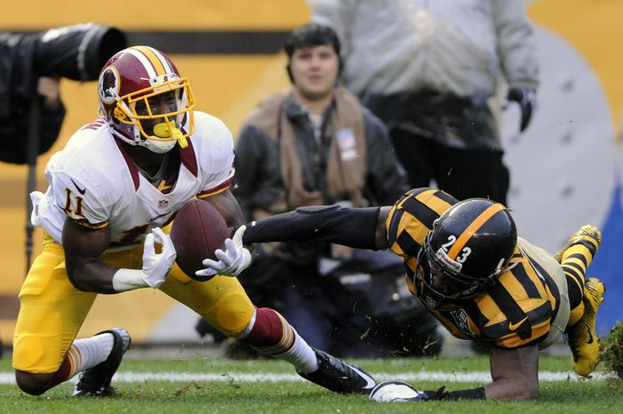 Washington Redskins wide receiver Aldrick Robinson (11) can't haul in a potential fourth quarter touchdown pass in front of Pittsburgh Steelers cornerback Keenan Lewis (23) at Heinz Field, Pittsburgh, Pa., Oct. 28, 2012. (Preston Keres/Special to The Washington Times)