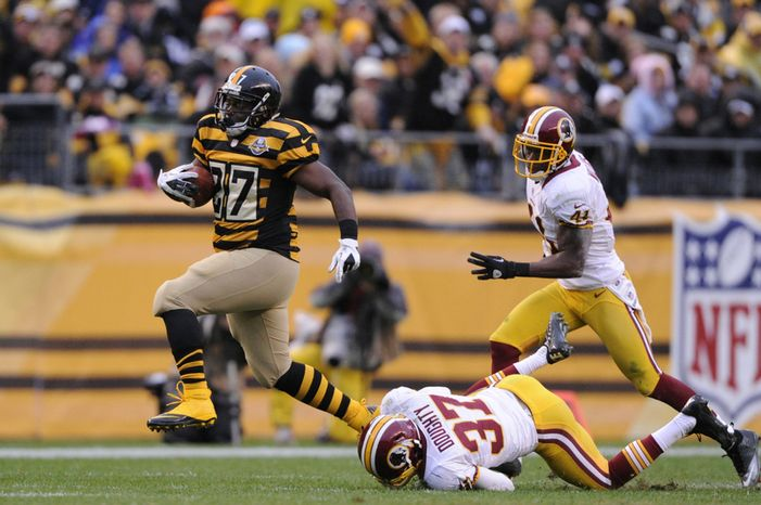 Pittsburgh Steelers running back Jonathan Dwyer (27) breaks free from Washington Redskins strong safety Reed Doughty (37) and free safety Madieu Williams (41) for a 34-yard run in the first quarter at Heinz Field, Pittsburgh, Pa., Oct. 28, 2012. (Preston Keres/Special to The Washington Times)
