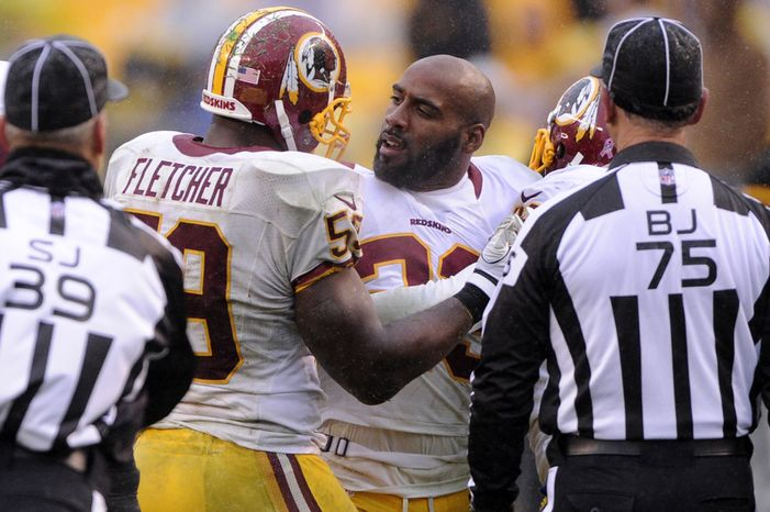 Washington Redskins cornerback DeAngelo Hall (23) is held back by London Fletcher (59) after being ejected from the game in the fourth quarter at Heinz Field, Pittsburgh, Pa., Oct. 28, 2012. (Preston Keres/Special to The Washington Times)