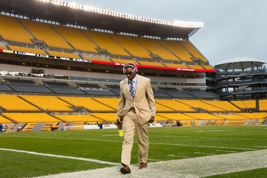 Washington Redskins quarterback Robert Griffin III (10) arrives early to walk the field before the Washington Redskins take on the Pittsburgh Steelers at Heinz Field in Pittsburgh on Sunday, Oct. 28, 2012. (Andrew Harnik/The Washington Times)