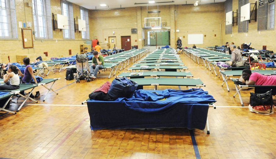 A public shelter in Seward Park High School on the lower east side begins to fill in preparation of the storm in New York.  (AP Photo/ Louis Lanzano)
