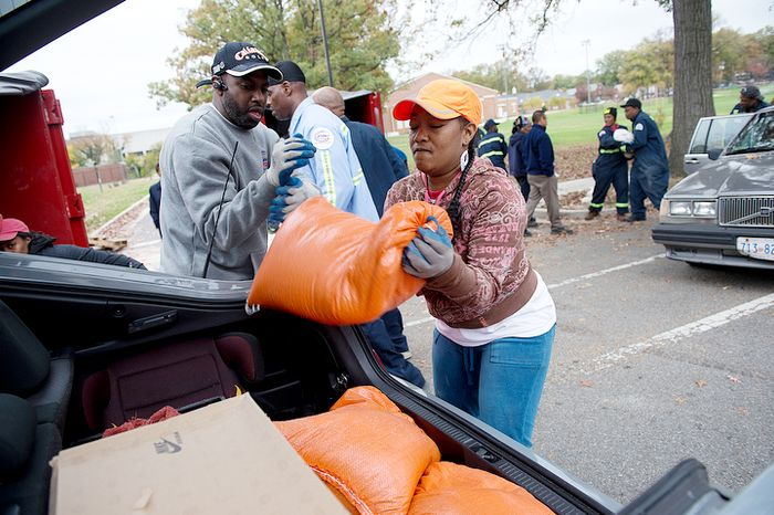 D.C. Department of Public Works employees, including Monique Hicks, right, load sand bags into District residents' cars outside of Coolidge High School in Washington, D.C. on Sunday, Oct. 28, 2012. DPW handed out some 10,000 bags at RFK on Saturday and had 5,500 more to hand out on Sunday.  (Barbara L. Salisbury/The Washington Times)