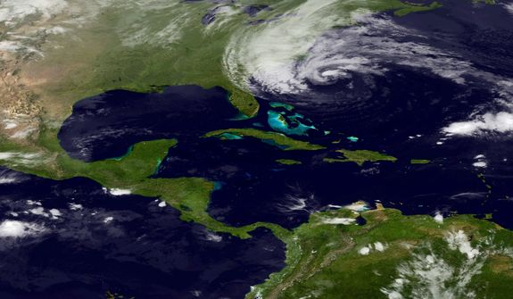 In this image taken by the National Oceanic and Atmospheric Administration's GOES East satellite on Sunday, Oct. 28, 2012, Hurricane Sandy is seen on the East Coast of the United States. (AP Photo/NOAA)