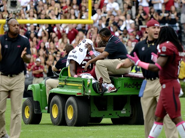 South Carolina running back Marcus Lattimore is taken off the field in a cart after getting injured during the first half of an NCAA college football game against Tennessee, Saturday, Oct. 27, 2012 at Williams-Brice Stadium in Columbia, S.C. (AP Photo/Richard Shiro)