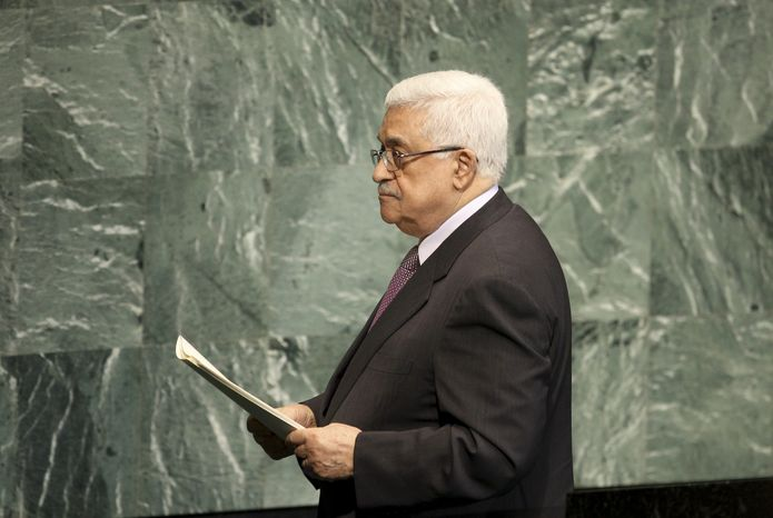 Palestinian President Mahmoud Abbas leaves the podium after speaking during the 67th session of the U.N. General Assembly at the world body's headquarters on Thursday, Sept. 27, 2012. (AP Photo/Seth Wenig)