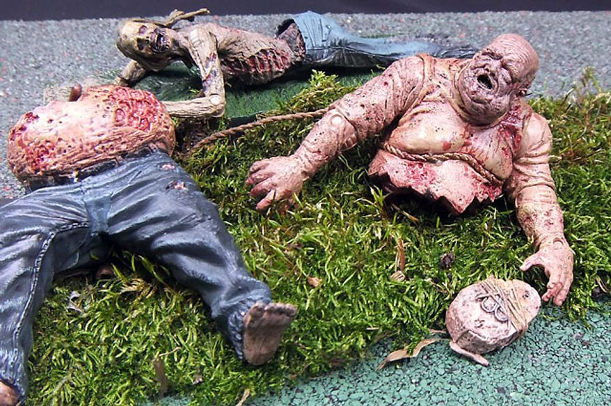 Well Zombies and Bicycle Girl Zombie are just two of the figures from McFarlane Toys' The Walking Dead TV Series 2 collection. (Photograph by Joseph Szadkowski / The Washington Times)