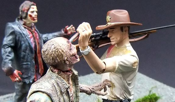 McFarlane Toys' RV Zombie meets his demise at the hands of Deputy Rick Grimes from The Walking Dead. (Photograph by Joseph Szadkowski / The Washington Times)
