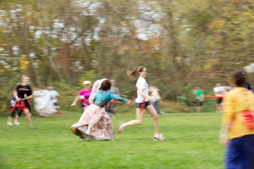 Lisa Renard-Spicer, dressed as a zombie bride, lunges after a runner at Run for Your Lives, a zombie infested 5k obstacle course run, in Darlington, MD. (Andrew S. Geraci/The Washington Times)