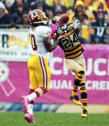 Washington Redskins quarterback Robert Griffin III (10) attempts to catch a pass from wide receiver Josh Morgan (15) in the second half against the Pittsburgh Steelers at Heinz Field, Pittsburgh, Pa., Sunday, Oct. 28, 2012. Griffin was called for offensive pass interference. (Craig Bisacre/The Washington Times)