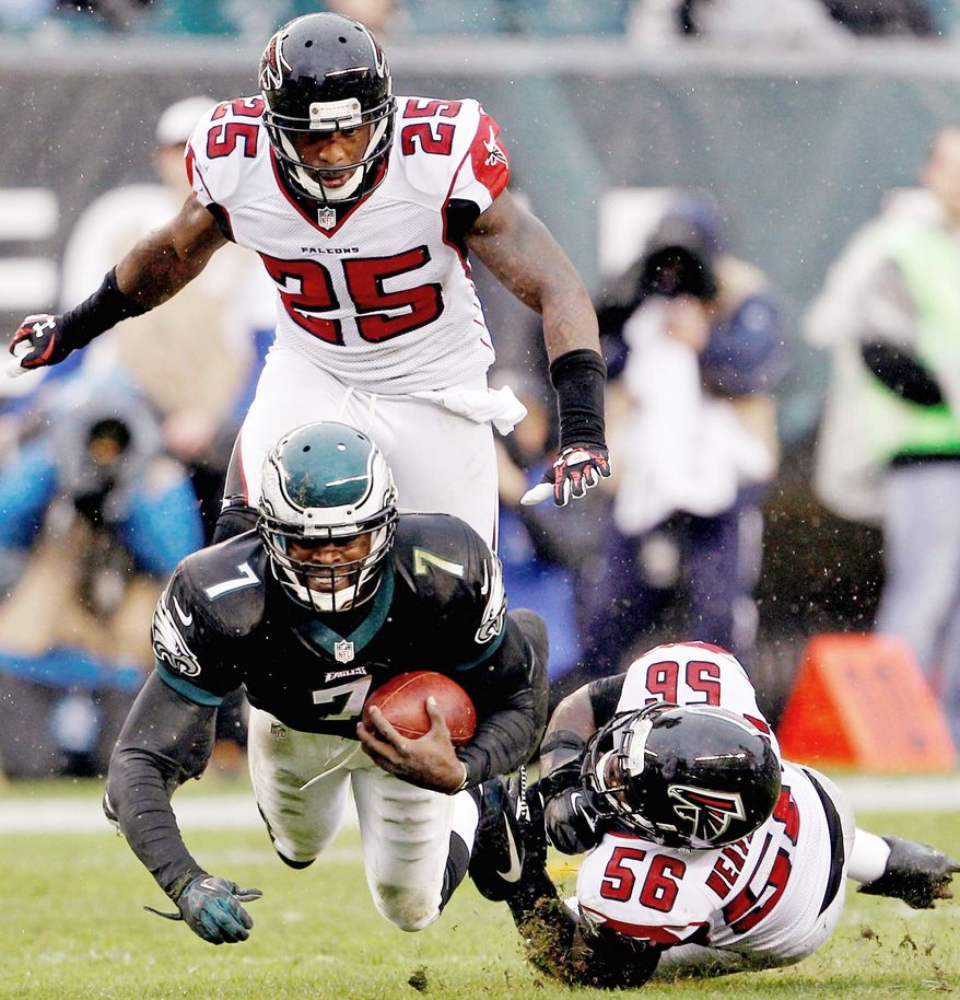 Quarterback Michael Vick has thrown eight interceptions as the Eagles have stumbled to a 3-4 start. Philadelphia may soon turn to Nick Foles. (Associated Press)