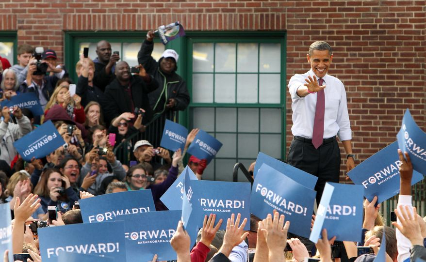 President Obama greets supporters as he arrives for a campaign event at the Elm Street Middle School in Nashua, N.H., on Saturday, Oct. 27, 2012. (AP Photo/Jim Cole)